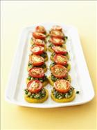Mini Polenta Rounds with Roasted Roma Tomatoes and Walnut Pesto